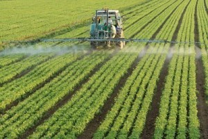 6431985-farming-tractor-spraying-a-field